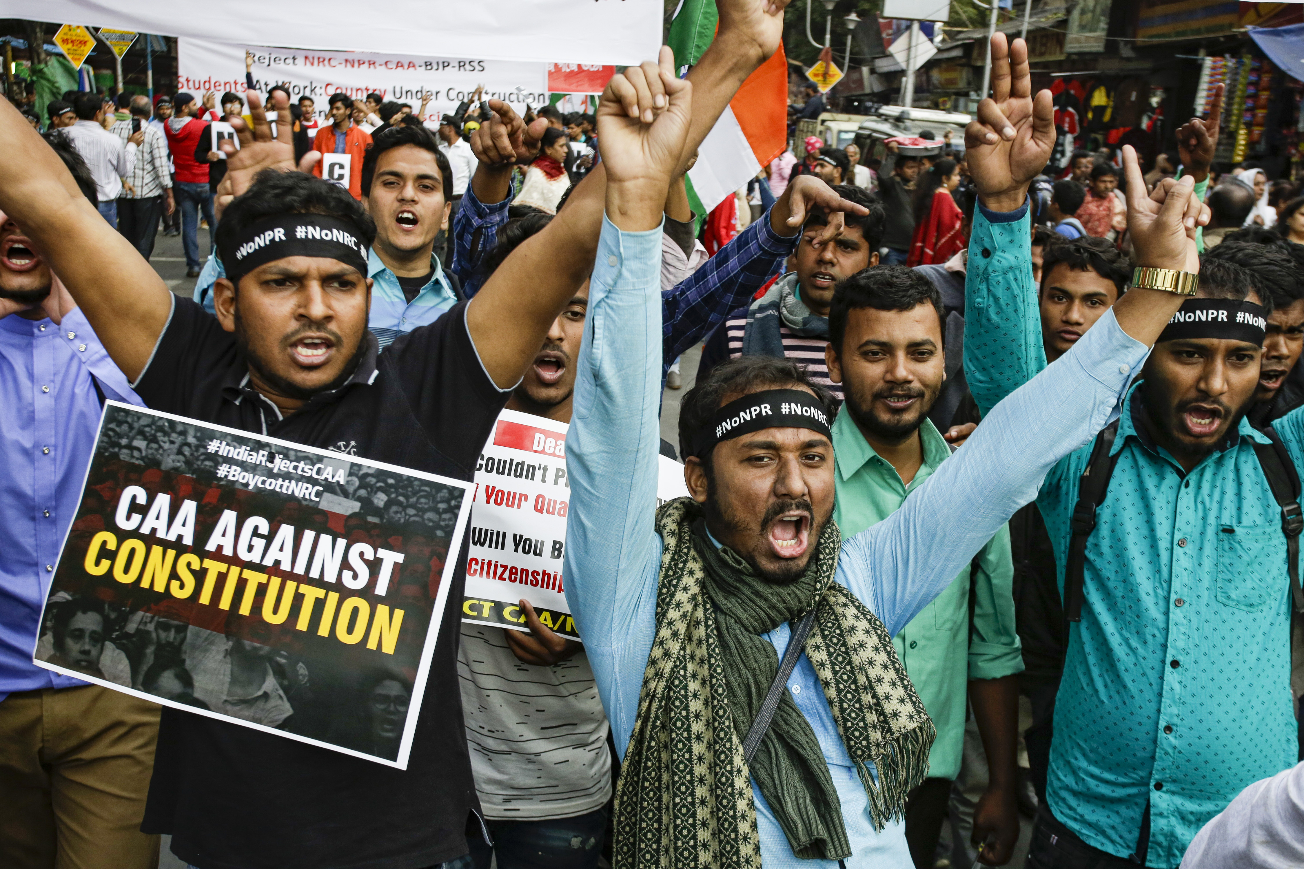 Students of different universities shout slogans as they protest the Citizenship law in Calcutta on Monday.