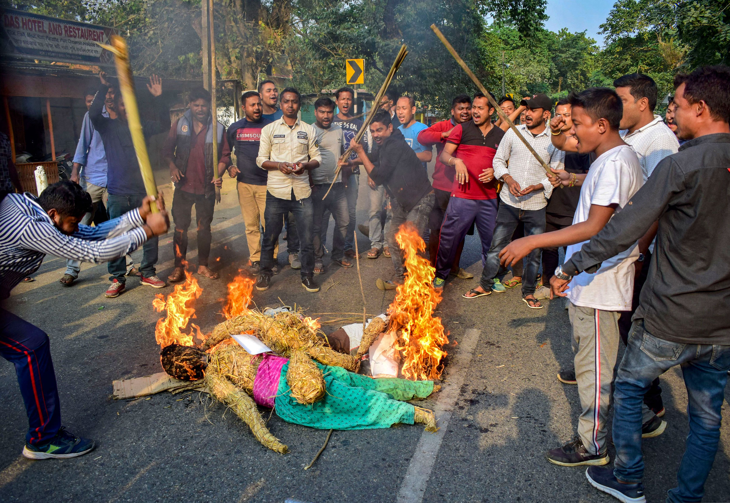 Demonstrators burn an effigy and shout slogans on National Highway 17 during a strike called by North East Students Union against the Citizenship Amendment Bill at Boko on Tuesday.