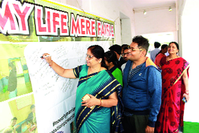 Visitors take part in the campaign at the vocational college in Jamshedpur on Saturday