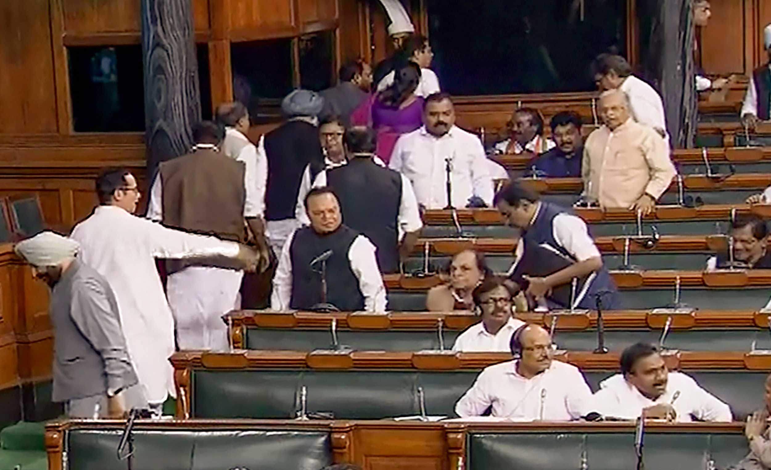 Congress and IUML party MPs walkout from the Lok Sabha in New Delhi on Wednesday. When the Delhi riots were being discussed in Parliament, the Sena did not join the Congress and other Opposition parties in pinning responsibility on Union home minister Amit Shah, leave aside demand his resignation.