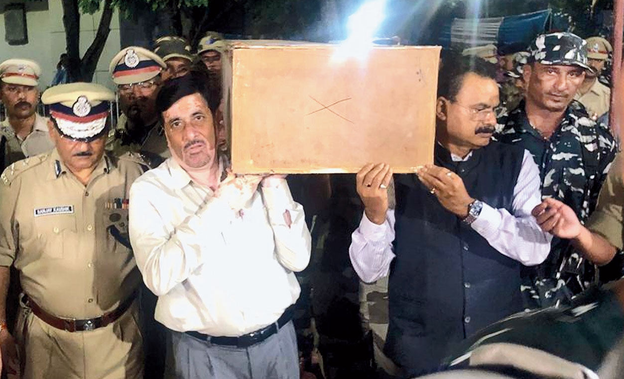 Assam industry and commerce minister Chandra Mohan Patowary and Hrishikesh Goswami, media adviser to the chief minister, carry the coffin of CRPF jawan Nirod Sarma at LGBI Airport in Guwahati on Thursday.