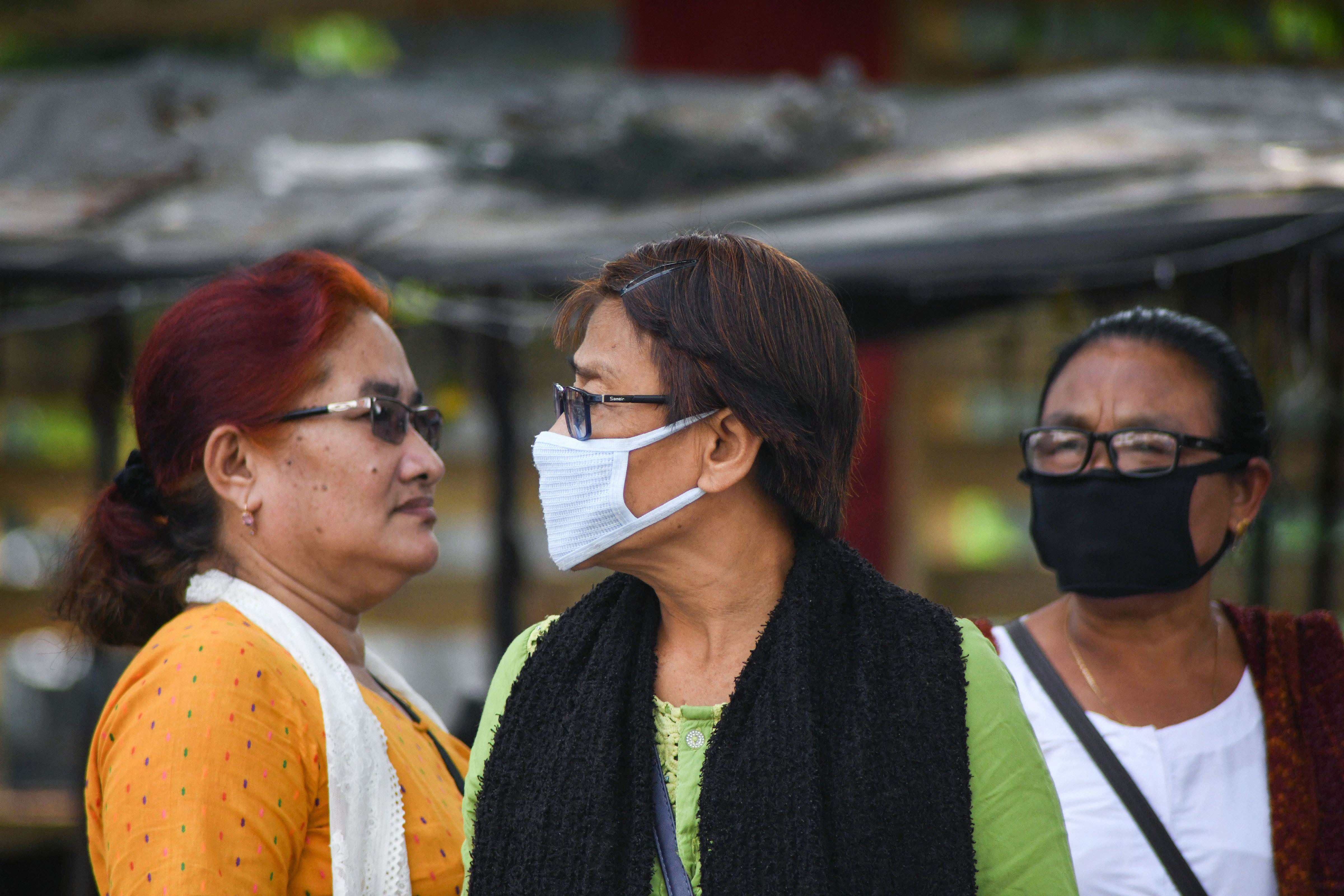 People wear masks amid heavy smog as the air quality dips to the hazardous levels, in Bodh Gaya, Monday, November 4, 2019.