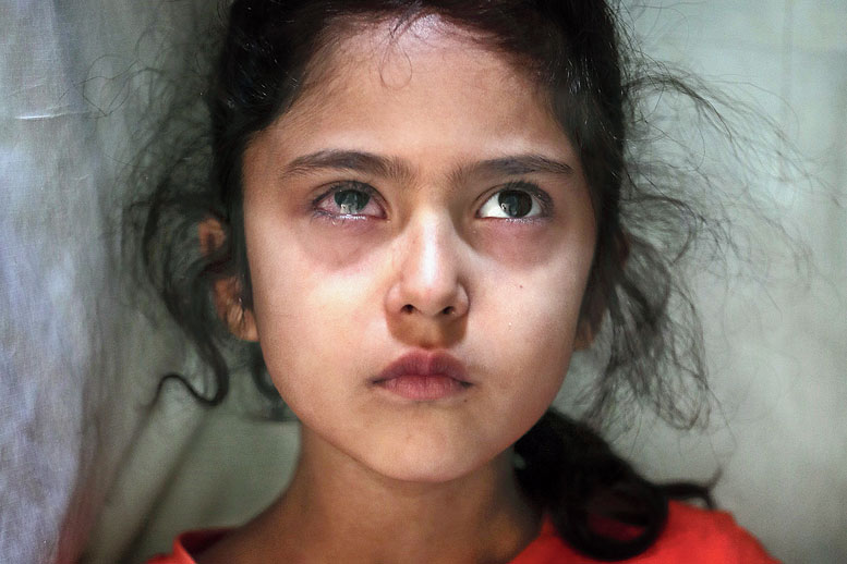 This photograph taken by Mukhtar Khan was among the 20 — 19 from Kashmir and one from Jammu, taken by three Associated Press photographers — which were chosen by the jury for the 2020 Pulitzer Prize for Feature Photography. The picture above shows six-year-old Muneefa Nazir, a Kashmiri girl, whose right eye was hit by a marble ball shot allegedly by paramilitary soldiers on August 12. When this picture was taken on September 17, 2019, the girl was standing outside her home in Srinagar. This photograph was published by The Telegraph also on its front page on September 27, last year.