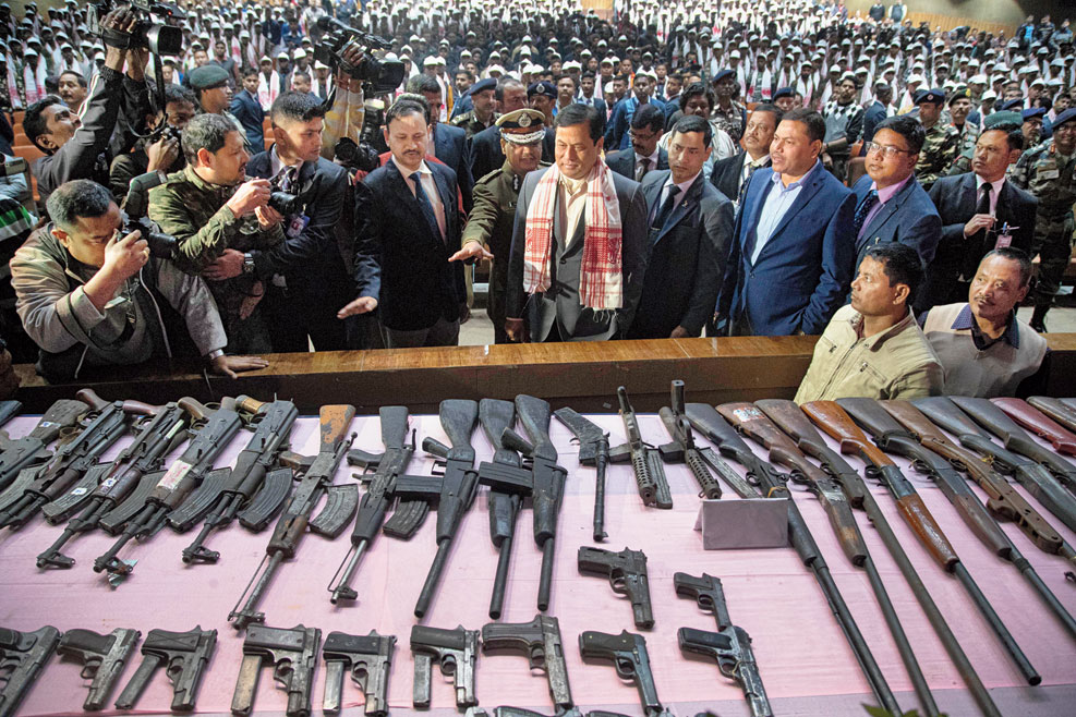 Assam chief minister Sarbananda Sonowal inspects arms and ammunition during the surrender ceremony in Guwahati on Thursday
