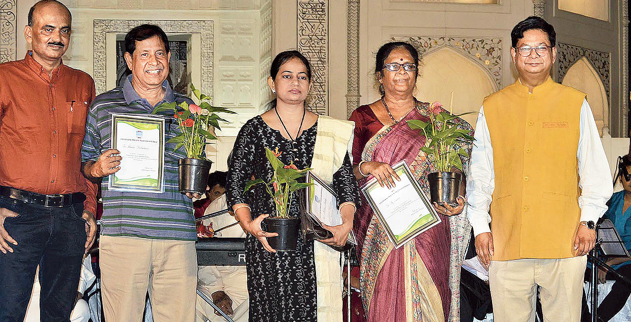 Debashis Sen (right) with three of the newly appointed honorary eco ambassadors.