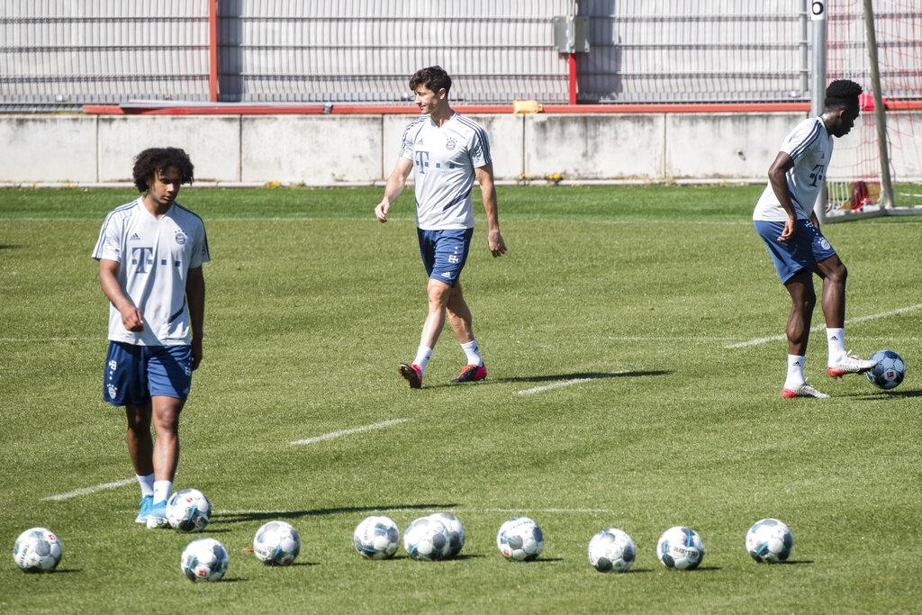 Joshua Zirkzee, Robert Lewandowski and Alphonso Davies from FC Bayern Munich practice at the club's training area in Munich
