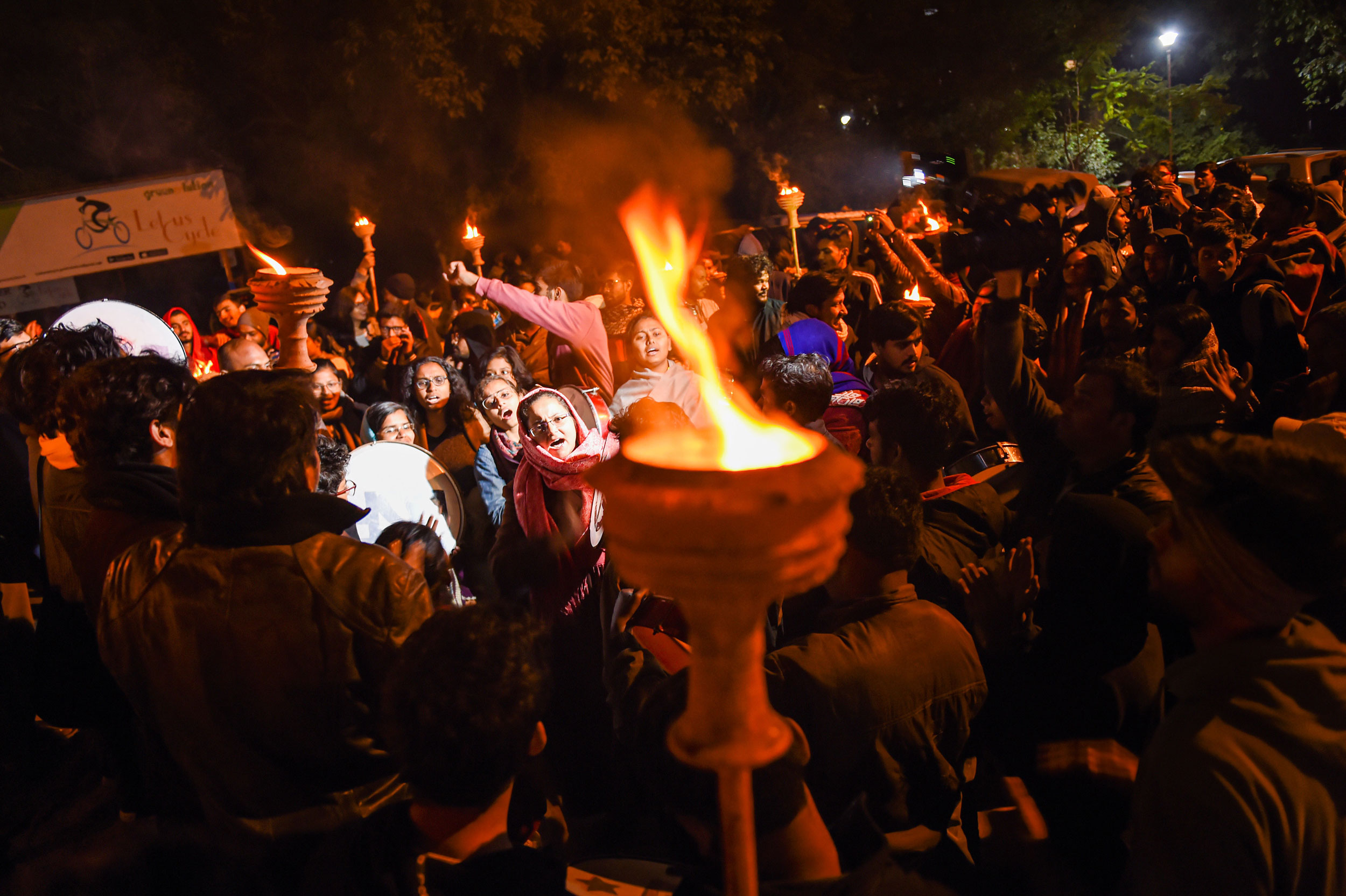 JNU students take part in a procession to protest against the proposed fee hike and IHA mannual on the university campus in New Delhi on December 3, 2019.