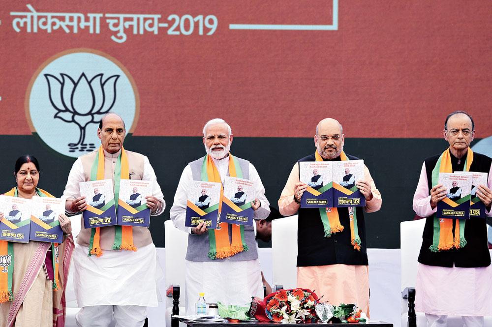 Narendra Modi alone on BJP manifesto cover, billboards