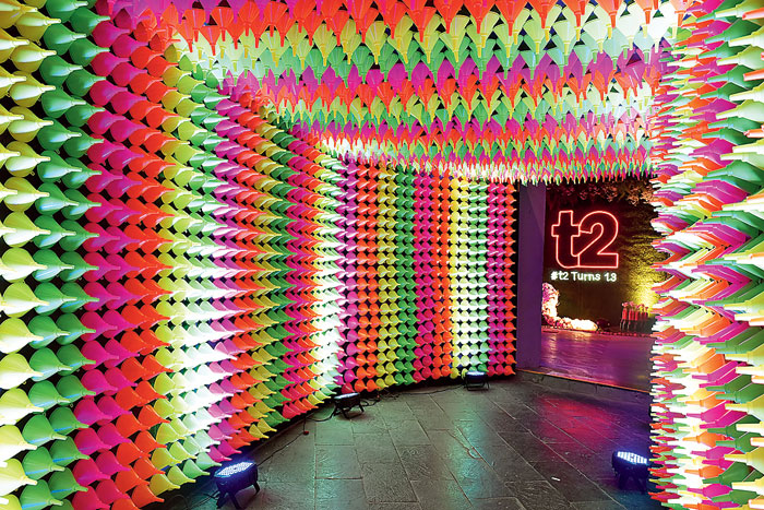 """Quirky, vibrant, colourful and neon summed up the tunnel that served as the main walkway to the party. It doubled as one of the most popular selfie spots too. """"The idea was to create a tunnel made of funnels in various neon shades like green, pink, yellow and orange, thus bringing out one of the themes of the party,"""" said Shiv Karira and Pepsi Kalwani of UD Events & More who were behind some of the main installations at the party."""