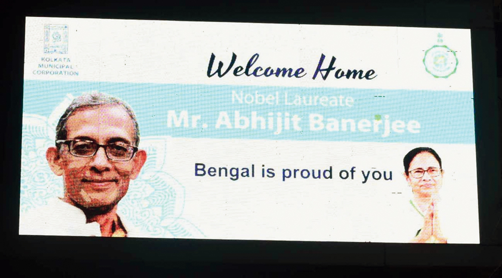 A new billboard with pictures of Abhijit Vinayak Banerjee and Mamata Banerjee