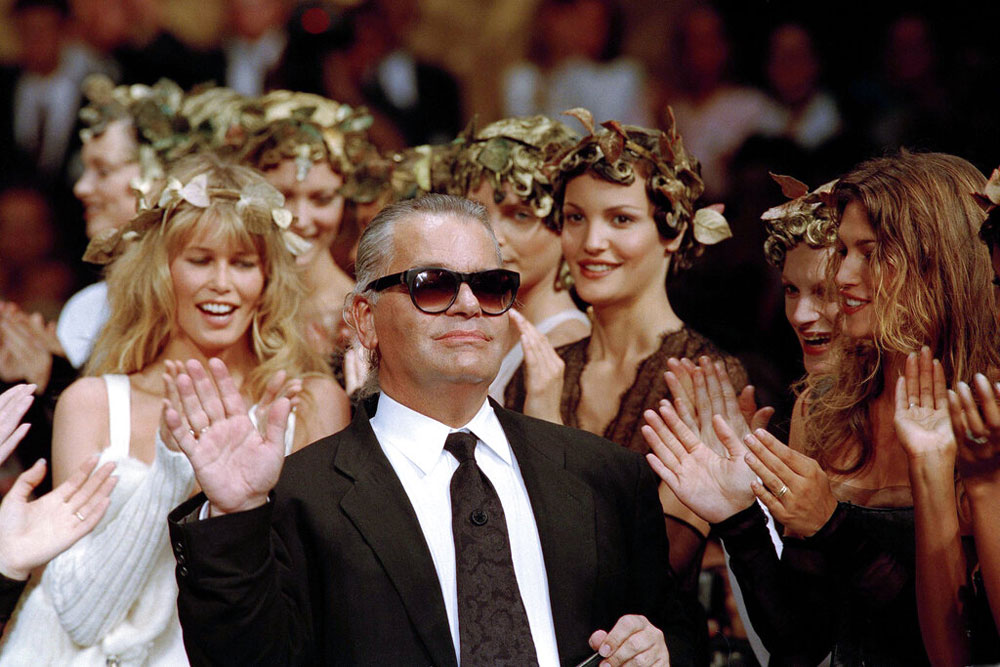 Karl Lagerfeld acknowledges the applause of his models at the end of the show he designed for the French fashion house Chanel, for the 1993-94 Fall-Winter haute couture collection in Paris, July 20, 1993.