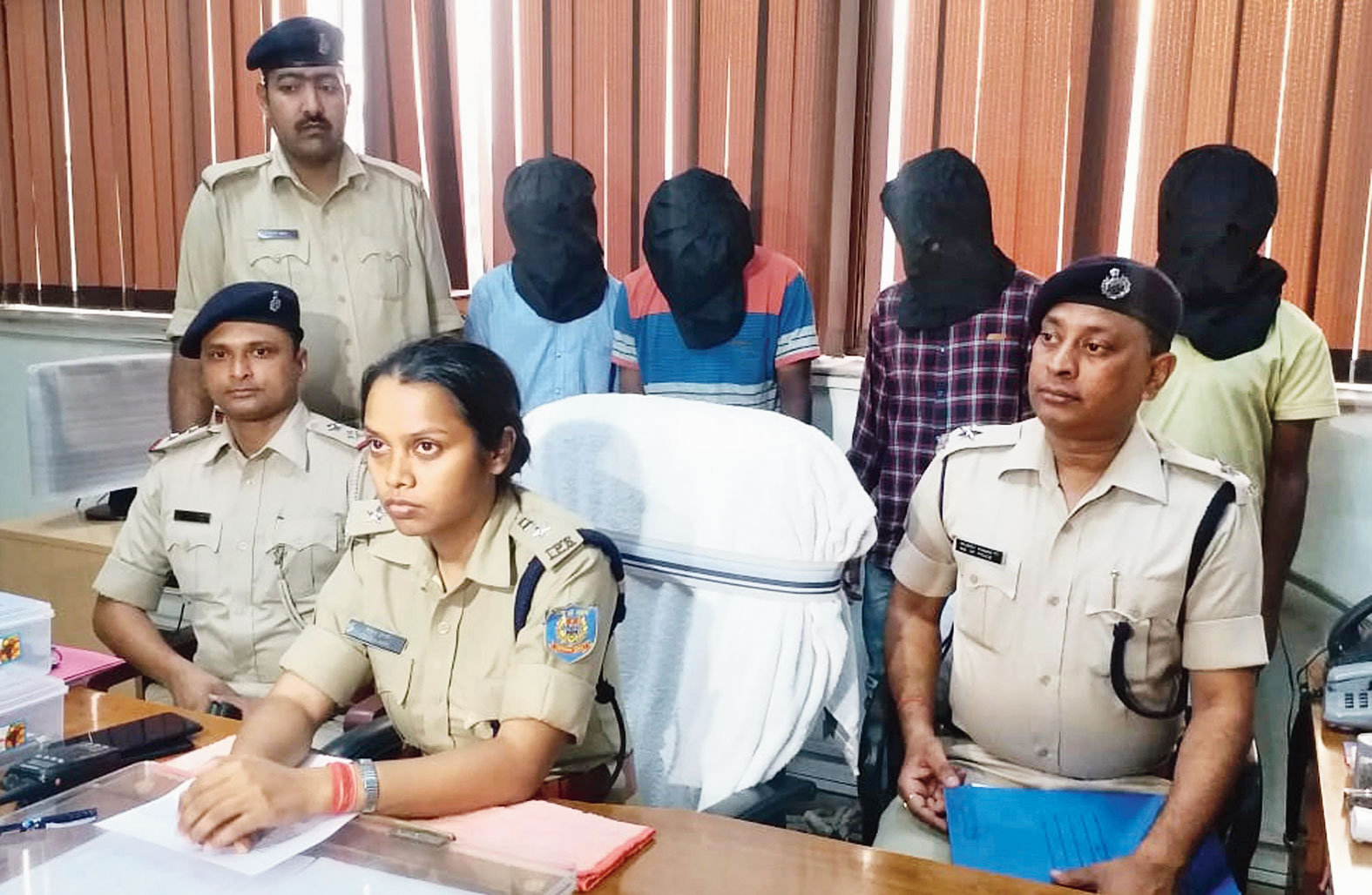 Ranchi SP (city) Sujata Kumari Veenapani with the murder suspects at her office on Saturday.