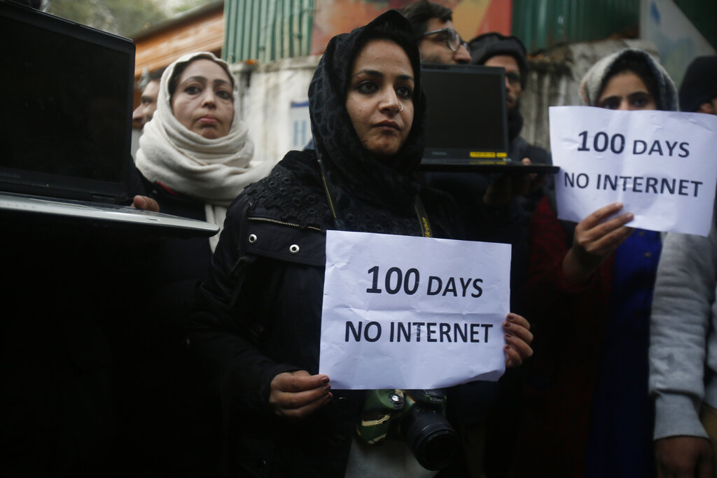Kashmiri journalists hold placards and protest against 100 days of internet blockade in the region in Srinagar, on Tuesday, November 12, 2019. Internet services have been cut since August 5 when Indian scrapped Jammu and Kashmir's semi-autonomous status under Article 370 of the Constitution
