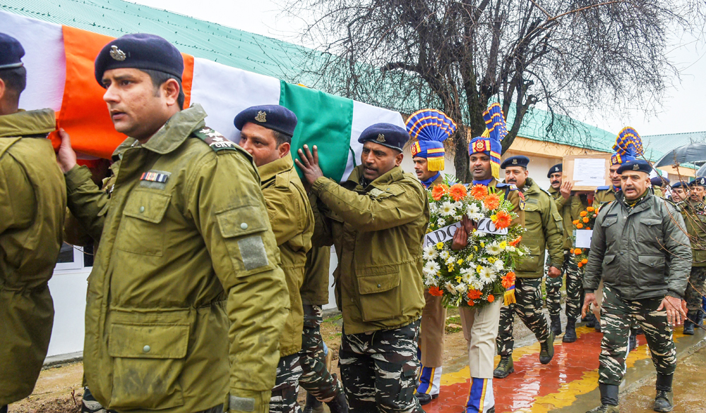 CRPF personnel carry the bodies of inspector Pinto Kumar Singh and Ct Vinod Kumar, who were killed in an encounter with militants at Babagund area in Langate of frontier Kupwara District in North Kashmir, after their wreath-laying ceremony on Saturday, March 2.
