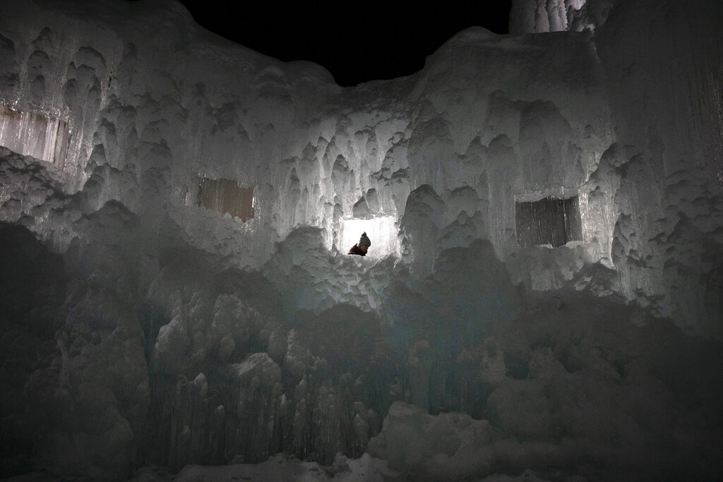 A tourist walks down the steps of an ice castle at the Lake Shikotsu Ice Festival in Chitose, Hokkaido
