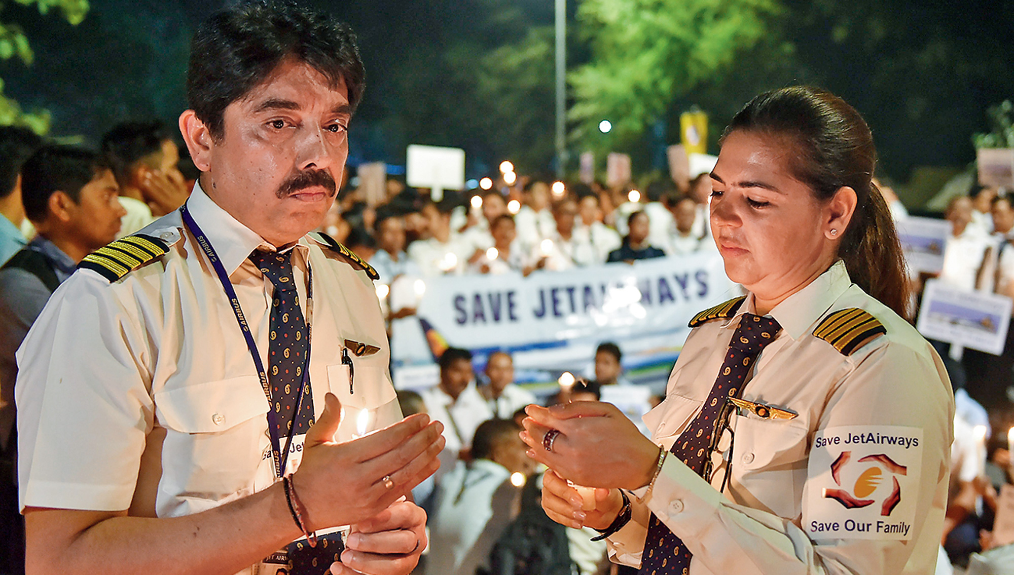 Jet Airways employees in New Delhi on Saturday hold a candle-light march to make an appeal to save the cash-starved airline.