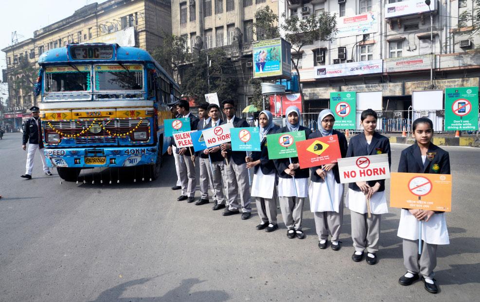 Students hold poster to create safety awareness during Road Safety Week on January 08, 2018 in Calcutta.