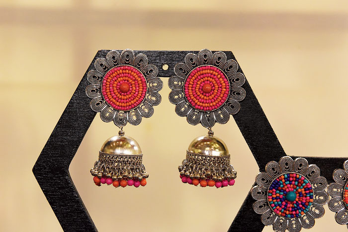 This pair of traditional German silver jhumkas with colourful beads can glam up any solid kurta or sari.  Rs 1,500 @Pooja Gandhi (find her on Instagram @poojagandhiofficial)