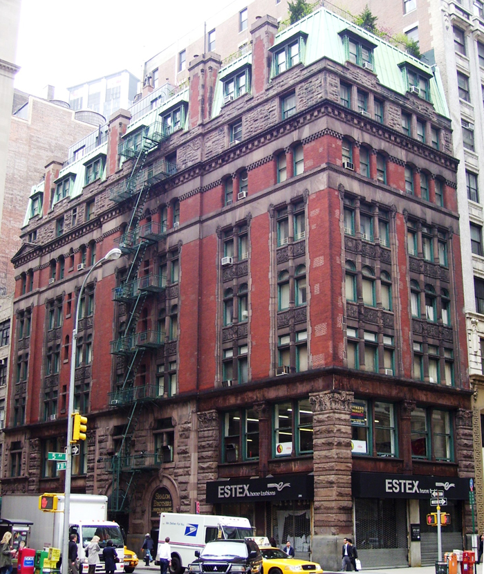 The mansard-roofed, brick-and-brownstone Wilbraham, so-called bachelor flats built on the site of two demolished brownstones