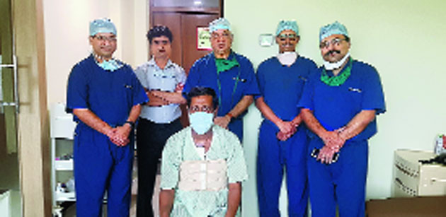 Amit Kumar Dey (seated) with the team of doctors who performed the heart transplant