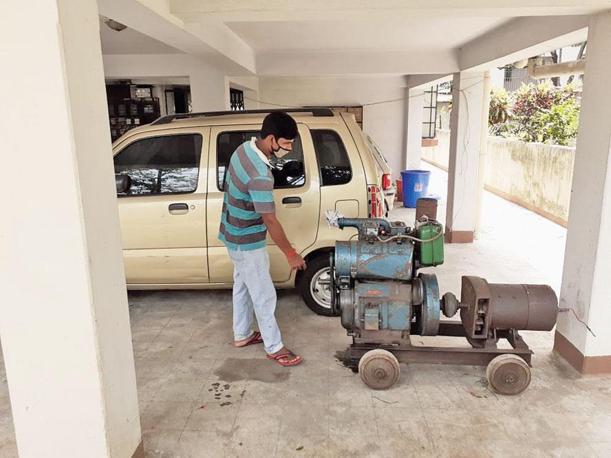 Tapas Halder, a generator supplier, checks his machine at Regent Estate on Wednesday.