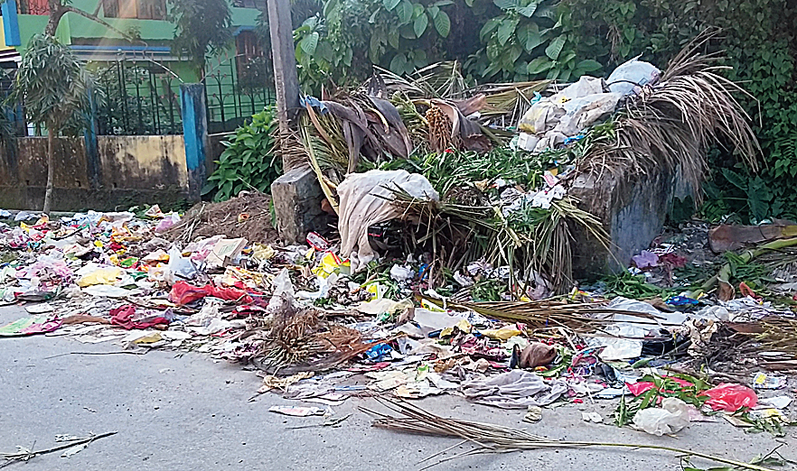 Trash strewn on a road in Alipurduar.