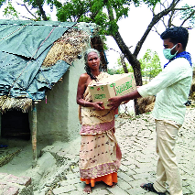 Ration being provided to a senior citizen in a North 24-Parganas village