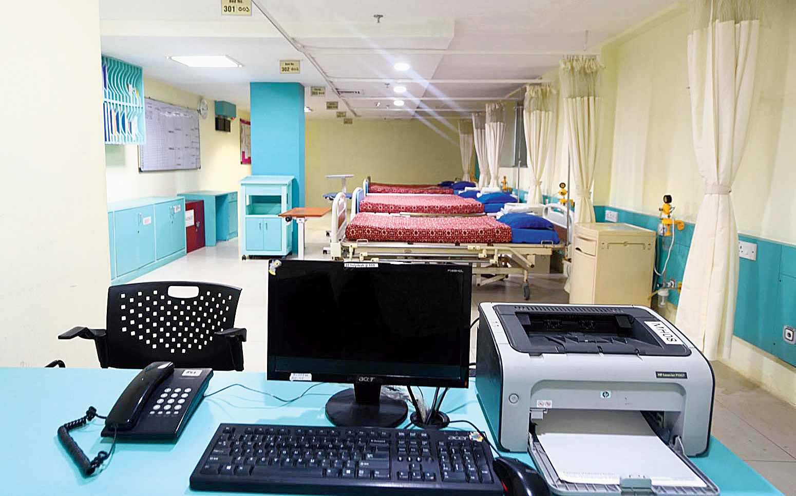 A ward created at Medica Superspecialty Hospital where patients who are to be admitted can be kept till a bed is available. Hospital officials say beds  remain occupied because delay in processing insurance claims prevents patients who have been discharged from leaving the hospital.