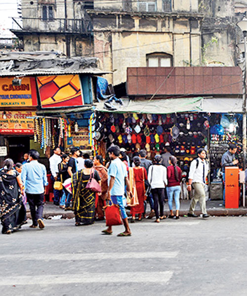 Pedestrians violating traffic rules at S.N. Banerjee Road in Calcutta.