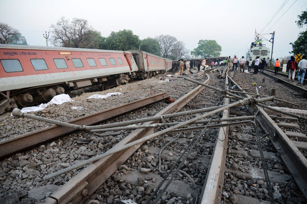 The derailed Howrah-New Delhi Poorva Express near Rooma railway station, about 20 km from Kanpur, Friday, April 20, 2019.