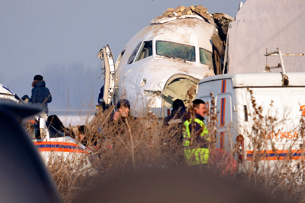 Rescuers on the site of a plane crash near Almaty International Airport on December 27