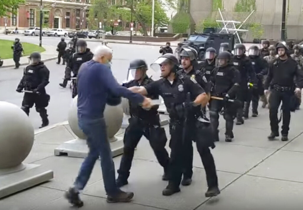 In this image from video provided by WBFO, a Buffalo police officer appears to shove the man who walked up to police on June 4