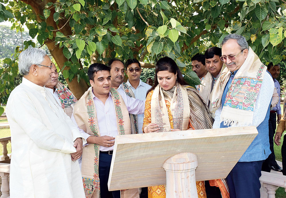 Chief minister Nitish Kumar takes the delegates from Gujarat to the Bodhi tree at his residence on Monday