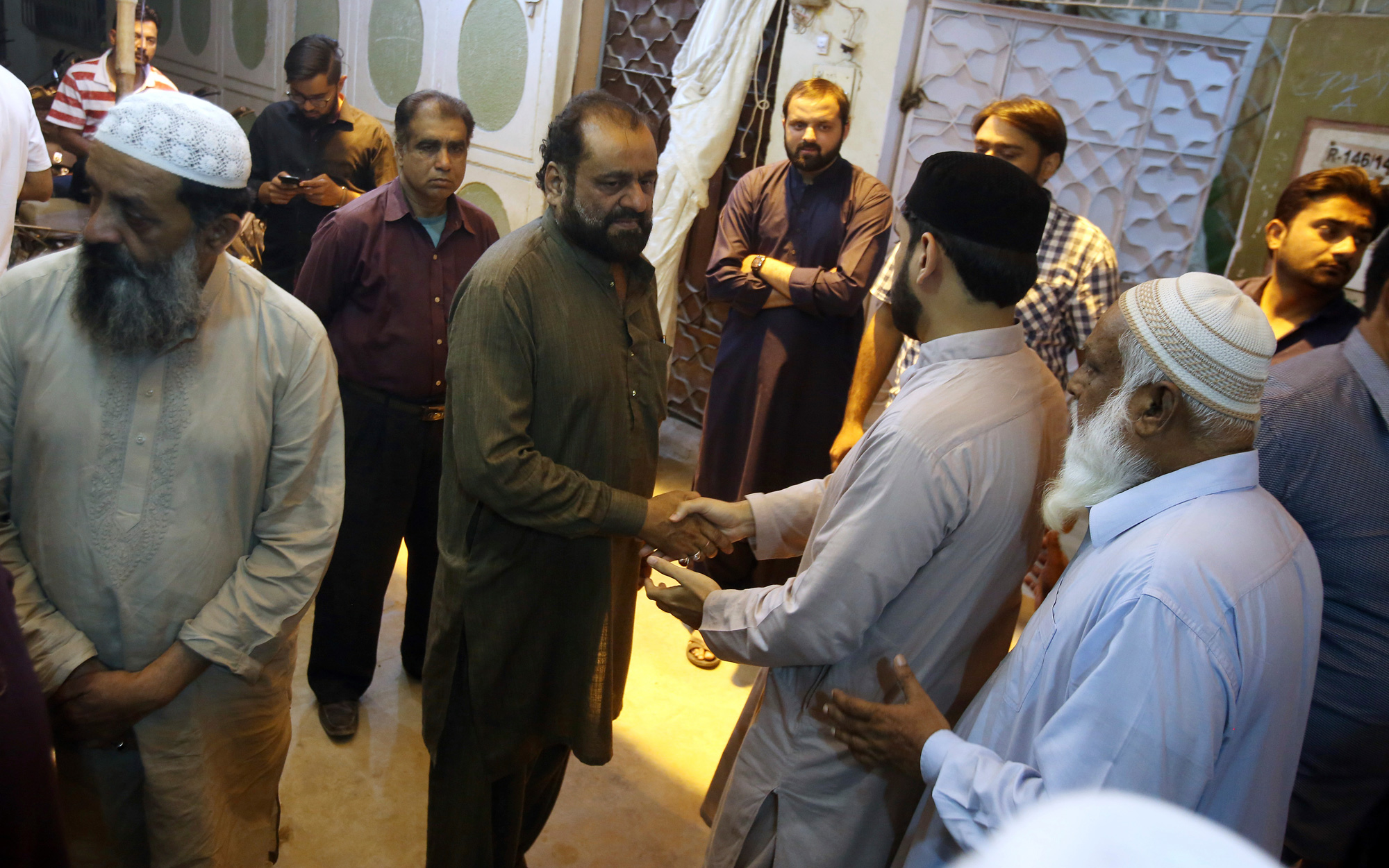 Relatives and neighbours offer condolance to Syed Ayaz Ahmed, father of Syed Areeb Ahmed, a Pakistani citizen who was killed at the Christchurch mosque shooting, at his home in Karachi, Pakistan on Saturday, March 16, 2019.