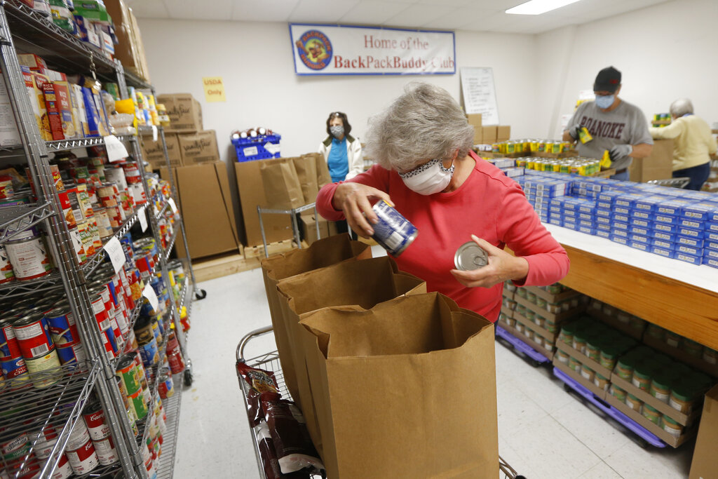 Hands Across Middlesex Food Pantry volunteer, Mary Ellen Sherwood, pack bags of food for their food pantry distribution Monday April 27, 2020, in Locust Hill, Viginia.