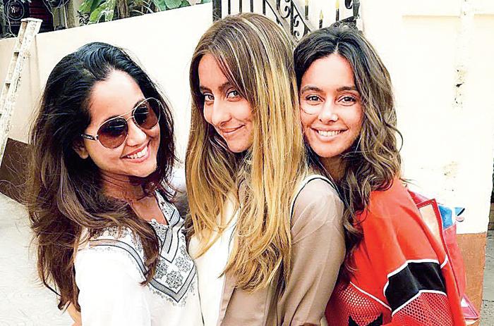 Anusha (centre) with sisters Shibani (right) and Apeksha