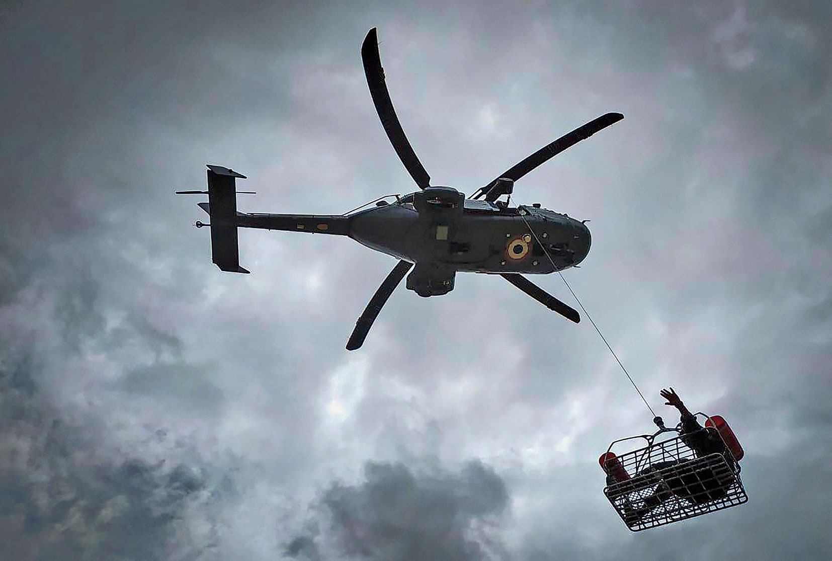 A flood victim being hauled into a navy helicopter from a flood-hit area in Maharashtra on Saturday. Kolhapur and Sangli are in the grip of a devastating flood.