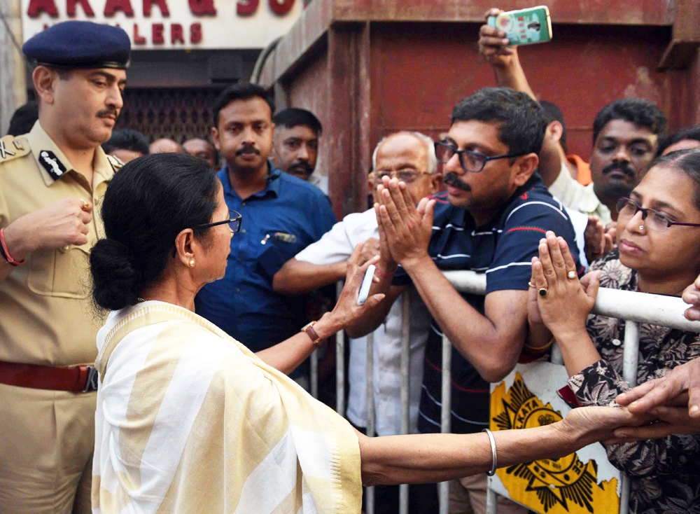 West Bengal Chief Minister Mamata Banerjee interacts with local residents of Bowbazar area, where several houses have been damaged owing to a tunnel boring for East-West Metro corridor, in Calcutta, Monday, September 2, 2019.
