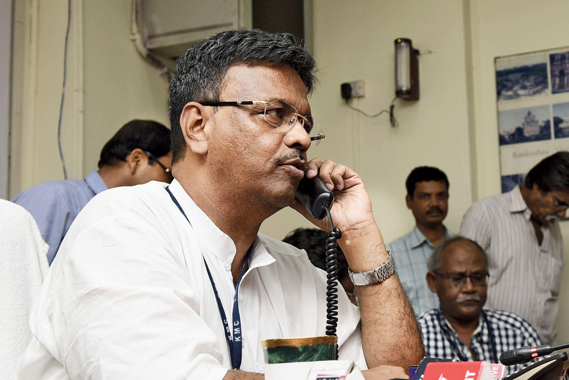 Mayor Firhad Hakim talks to a Calcuttan over the phone on Wednesday.