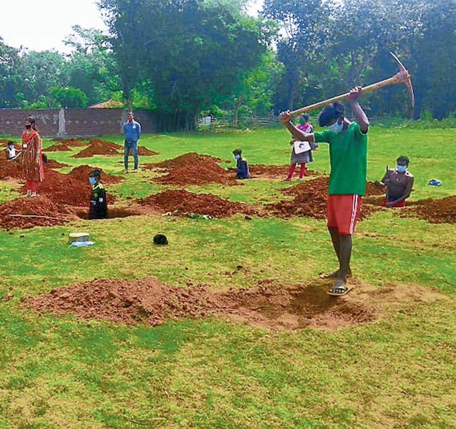 Workers dig ditches in a village in Jharkhand.