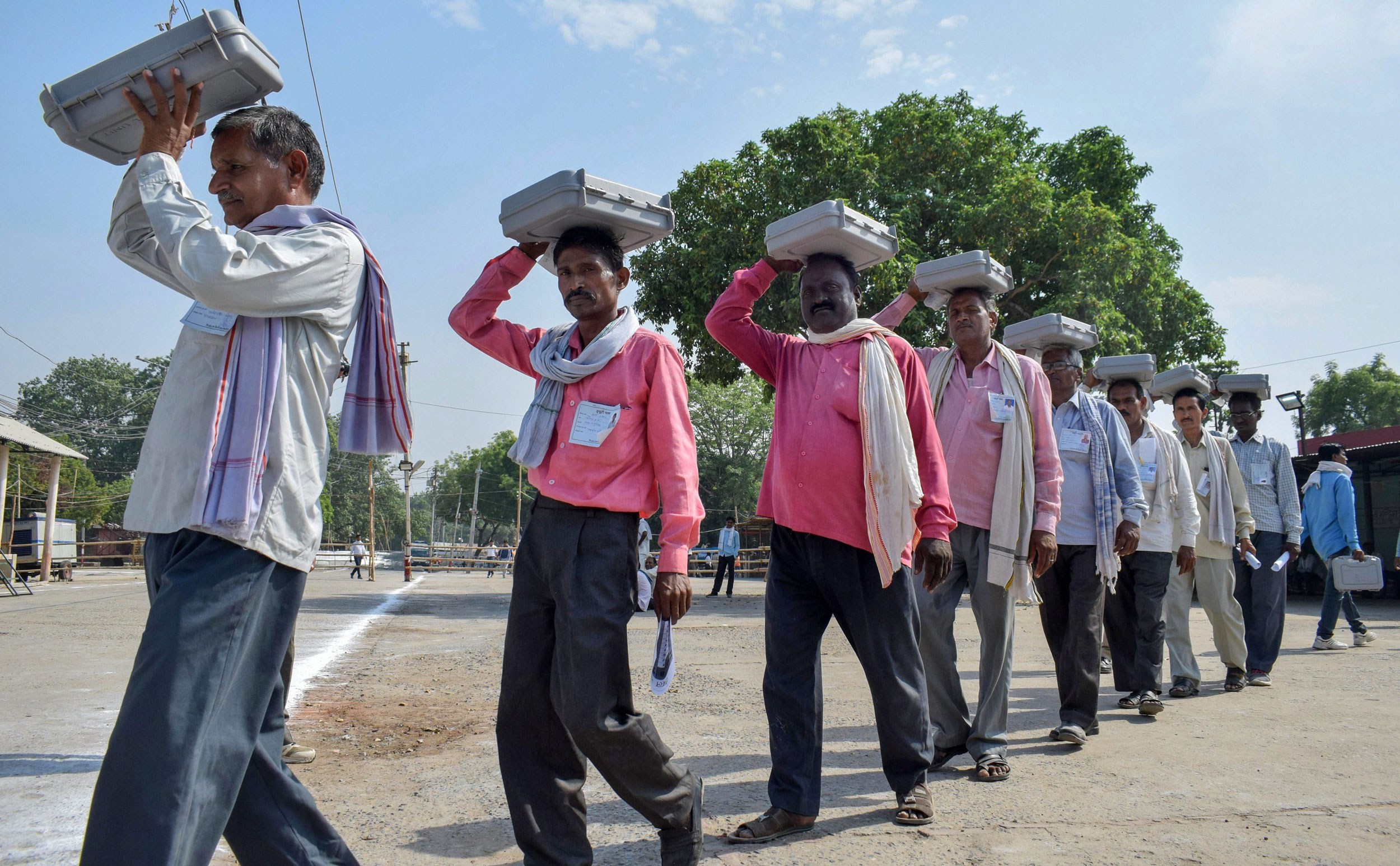 Poll officials arrive at a counting centre with EVMs, on the vote counting day for the 2019 Lok Sabha elections, in Allahabad, on May 23, 2019.