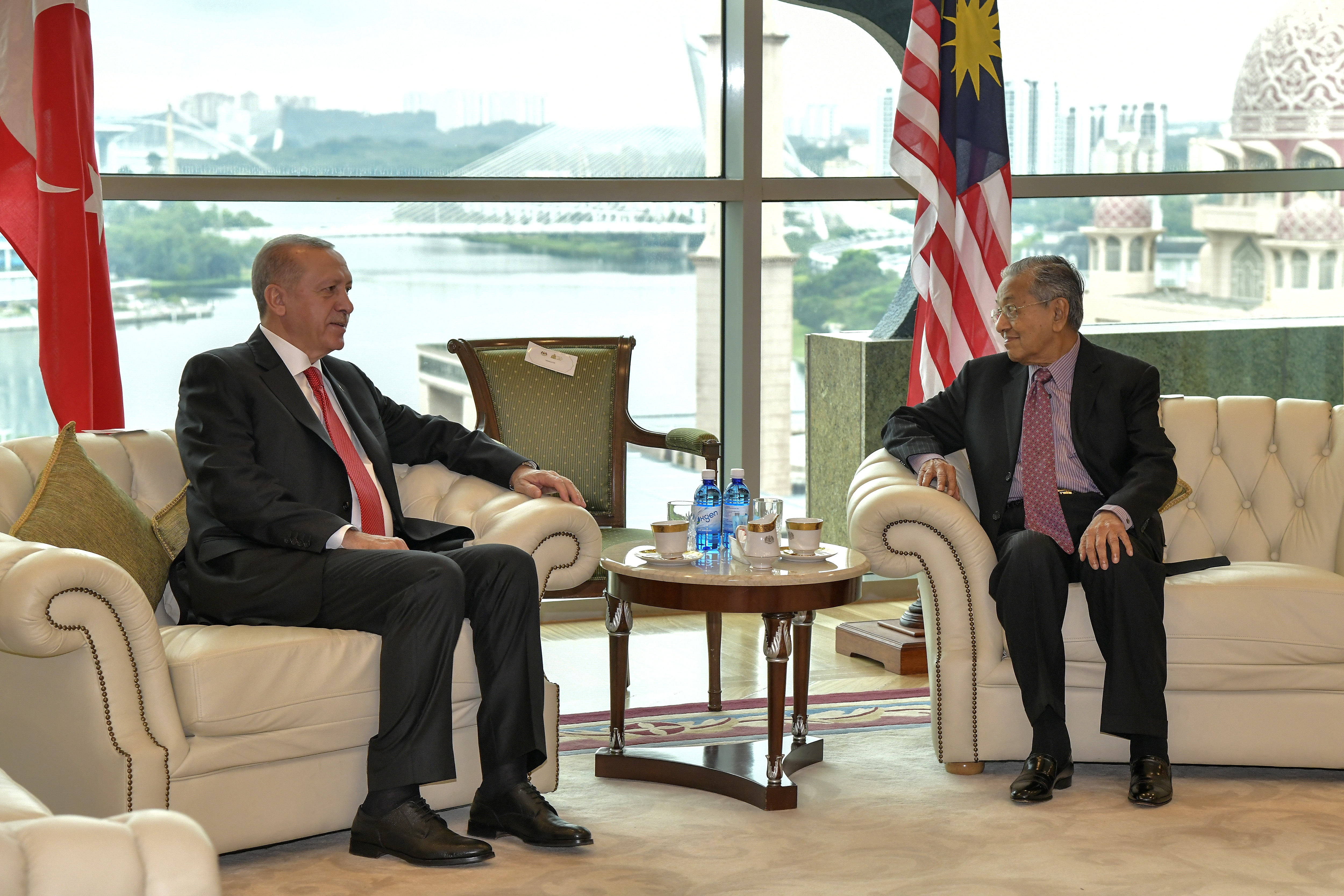 In this photo released by Malaysia's Department of Information, Turkey's President Recep Tayyip Erdogan, left, talks to Malaysia's Prime Minister Mahathir Mohamad during a meeting in Putrajaya, Malaysia, on December 18, 2019.