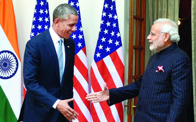 "Obama with Modi in New Delhi in 2015 when the Indian Prime Minister famously and repeatedly referred to the then US President as ""Barack"" and wore the monogrammed suit that sired the slogan ""suit-boot ki sarkar""."