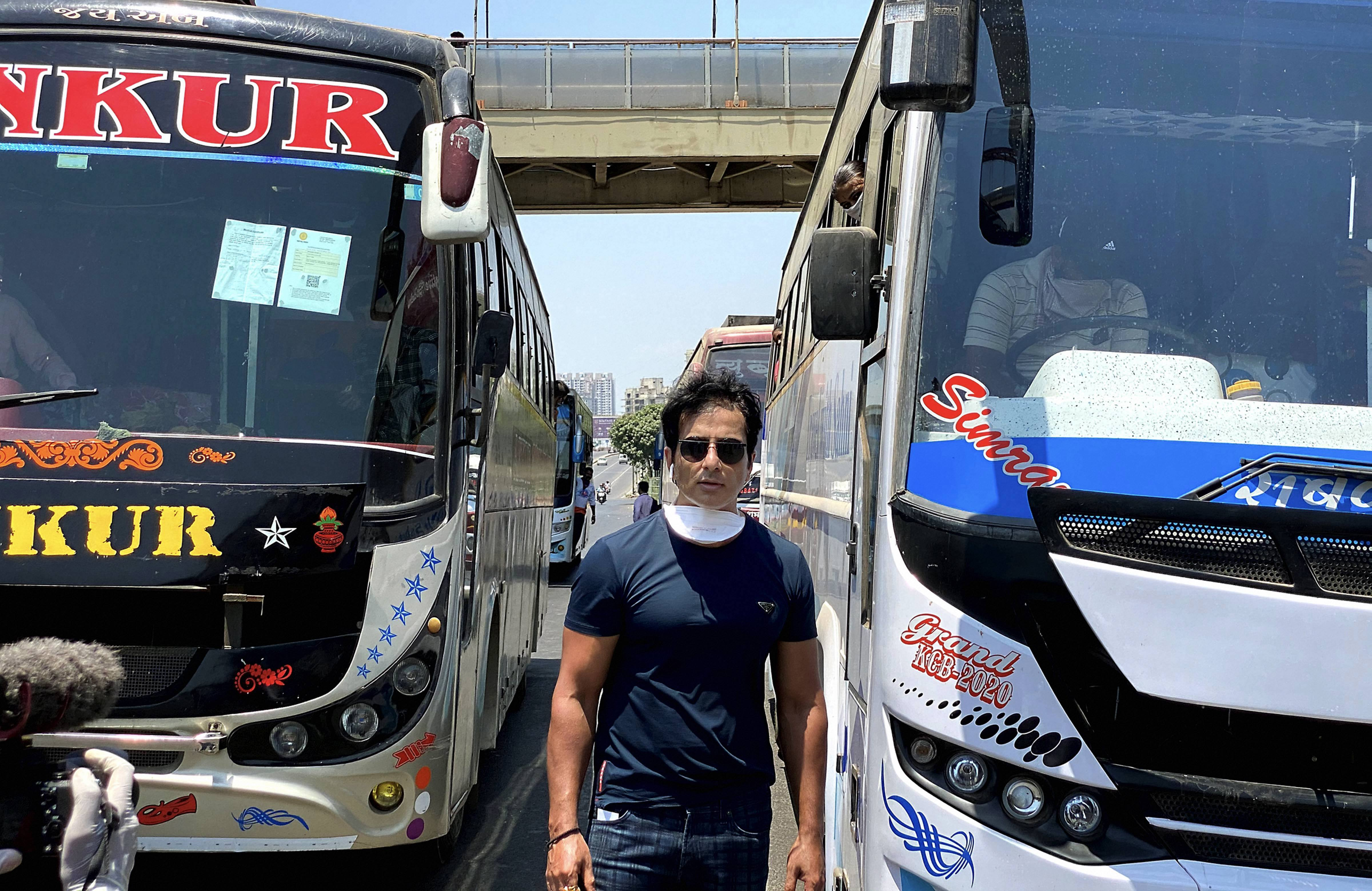 Bollywood actor Sonu Sood while sending off 350 migrant workers to their native places in Karnataka by buses, amid Covid-19 lockdown in Mumbai, Monday, May 11, 2020.