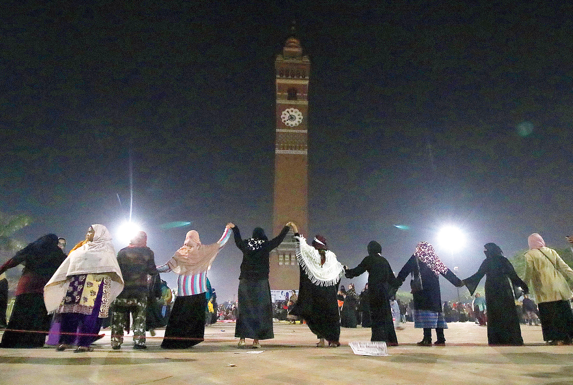 Women form a human chain around the clock tower in Lucknow in Sunday evening.