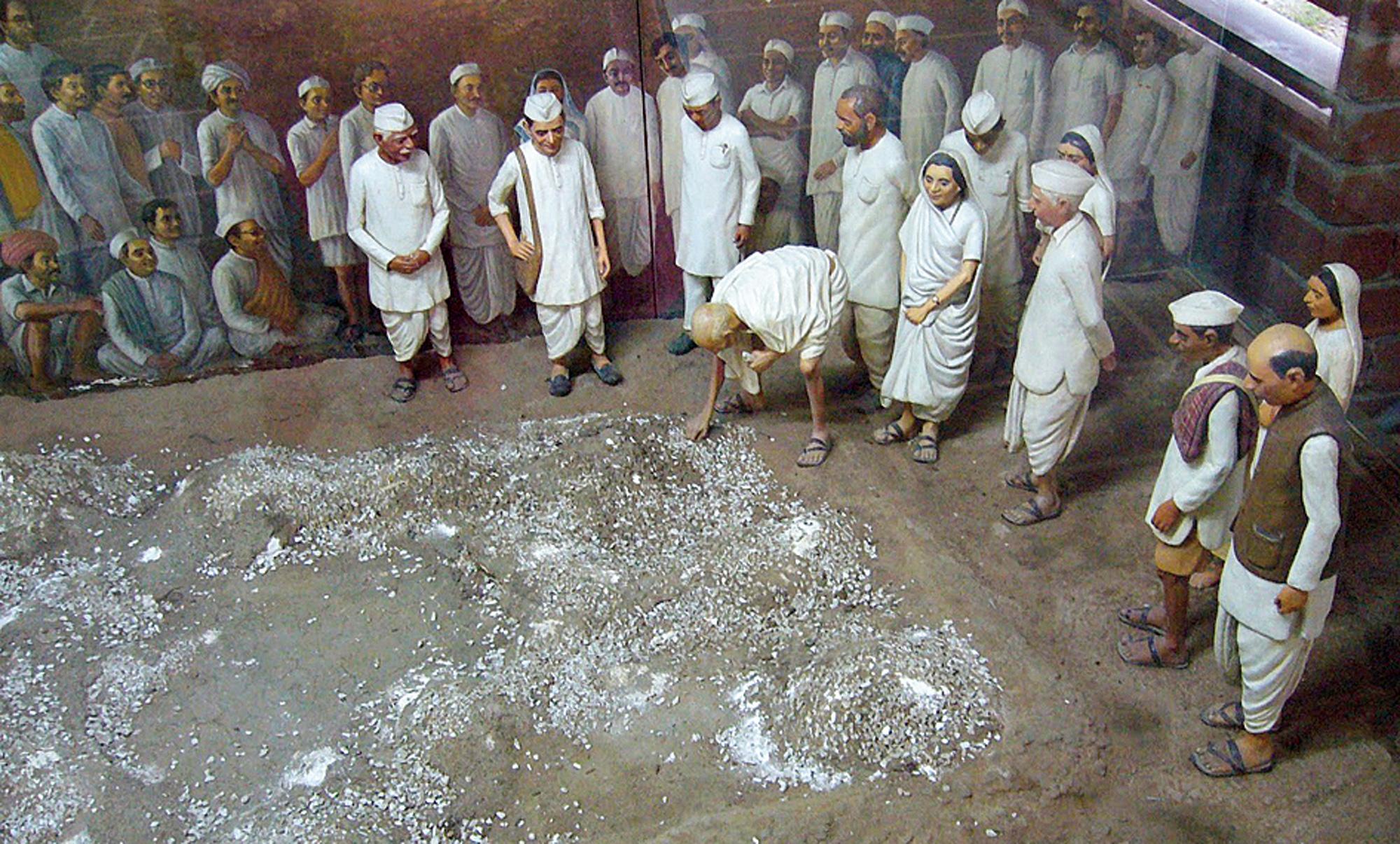 An exhibit on Gandhi picking salt after the Dandi March