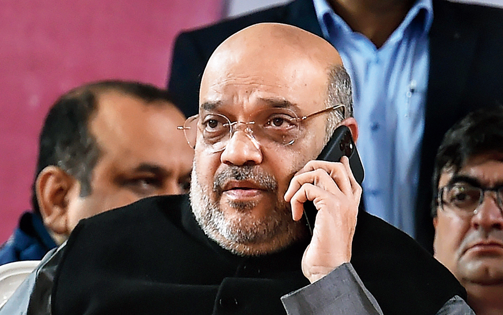 Home minister Amit Shah on the phone during a BJP event in New Delhi on January 5