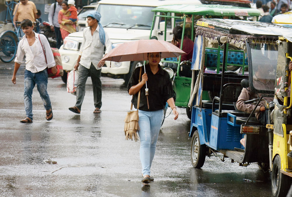 A woman with an umbrella on a rainy Wednesday afternoon on Main Road in Ranchi on Wednesday.