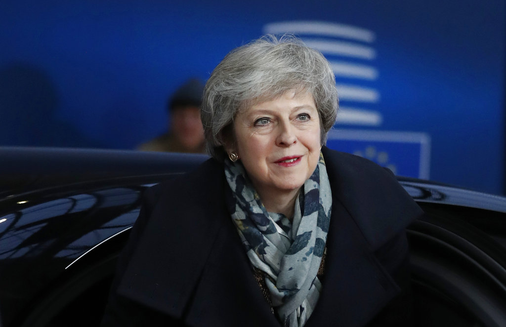 Theresa May arrives for an EU summit in Brussels on Friday.