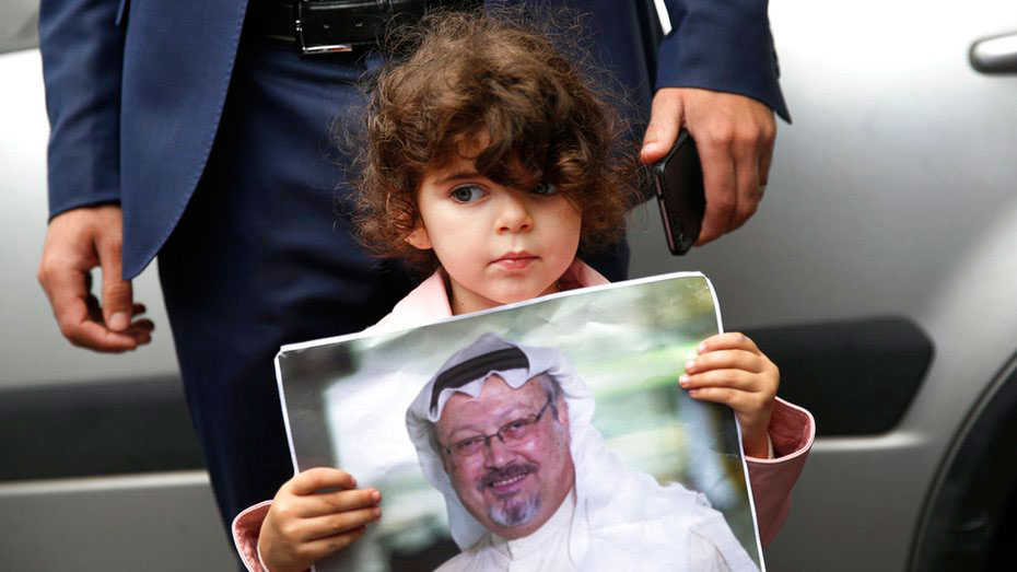 A girl holds a poster with a photo of Jamal Khashoggi during a protest near the Saudi consulate in Istanbul on October 9, 2018.